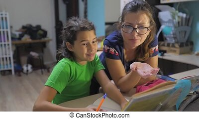 mother and daughter do homework school. slow motion video....