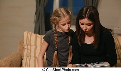 Mother and daughter doing a school homework assignment. Mom helps to deal with it