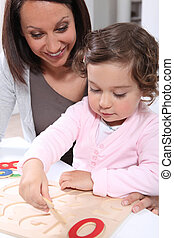 Mother and daughter doing a wooden