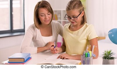 mother and daughter doing homework together - education,...