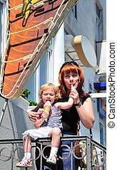 mother and daughter eating an ice-cream