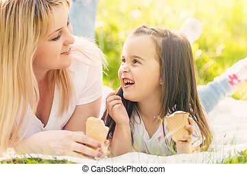 Mother and daughter eating ice-cream