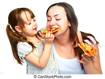 mother and daughter eating pizza - young mother and her ...