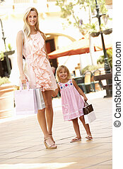 Mother And Daughter Enjoying Shopping Trip Together