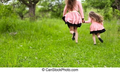 mother and daughter flee - Mom and daughter running in...