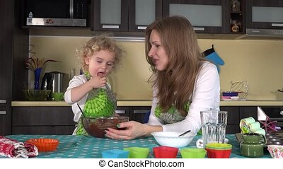 nice mother and little daughter friendly taste dough for cookies. home idyll in the kitchen. 4K