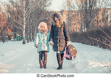 mother and daughter go from school