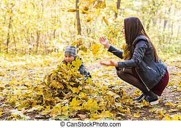 Mother and daughter have fun in autumn park