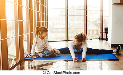 Mother and daughter have fun in the gym