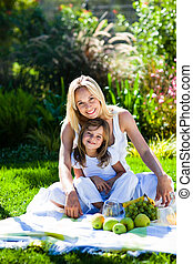 Mother and daughter having a picnic
