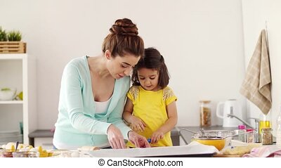 mother and daughter having fun at home kitchen