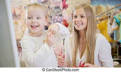 aaef5cfe26 Mother and daughter dancing in the mirror in the same dress in a big ...