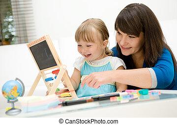 kindergarten - mother and daughter having fun in...
