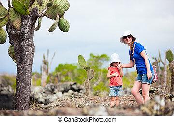 Mother and daughter hiking at Galapagos islands