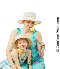 Mother and daughter hold one flower of yellow tulips isolated on white background.