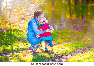 Mother and daughter in a park