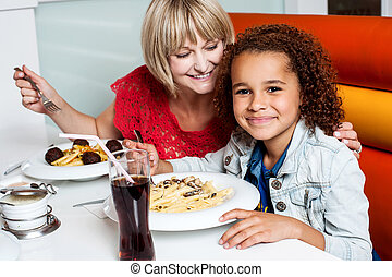 Mother and daughter in a restaurant