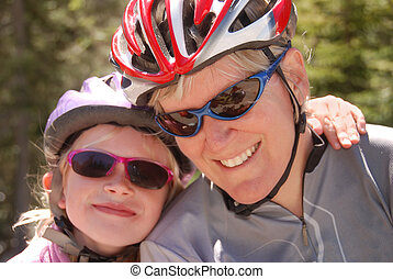 Mother and daughter in bicycle helmets