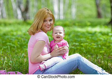 Mother and daughter in birch spring park
