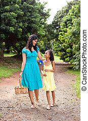 mother and daughter in fruit garden