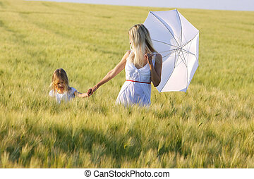 mother and daughter in green field