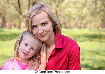 Mother and daughter in park in spring