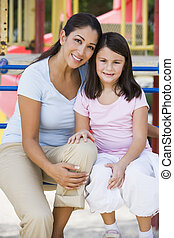 Mother and daughter in playground