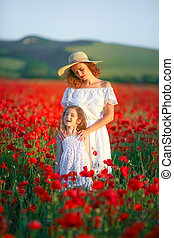 Mother and daughter in poppy field Royalty Free Stock Images...