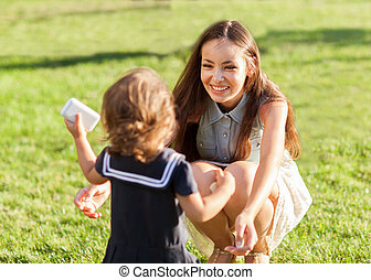 Mother and daughter in the park happy