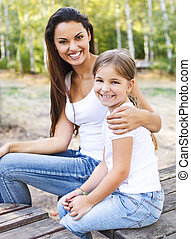 Mother and daughter in the summer park