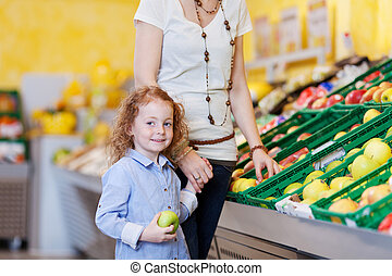 Mother and daughter in the supermarket