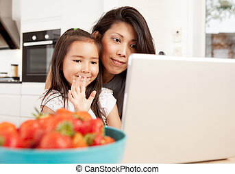 Mother and Daughter in Video Chat
