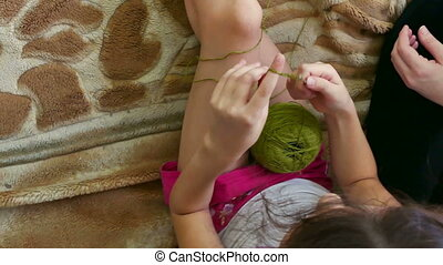 Mother and daughter knitting - woman and lifestyle teen girl...