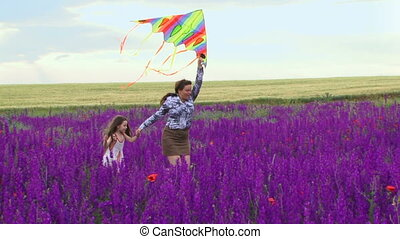 Mother and daughter launch a kite - A woman with a small...