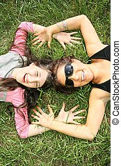 mother and daughter lie on the grass 2
