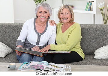 Mother and daughter looking at a picture album together