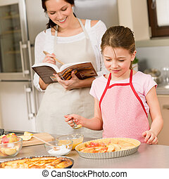 Mother and daughter make apple pie recipe - Mother and...