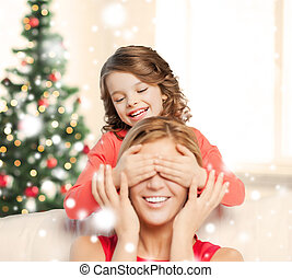 mother and daughter making a joke
