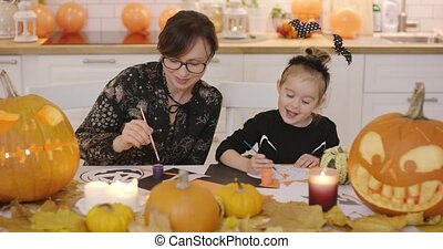 Mother and daughter making decorations - Mother and daughter...