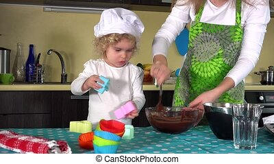 Mother and daughter mixing dough together and preparing for ...