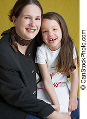 mother and daughter - mother with her smiling daughter