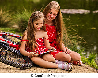 Mother and daughter on bicycle. Bikes cycling family.