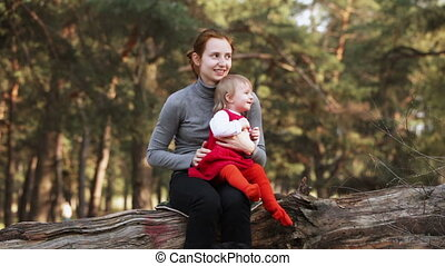 Mother and daughter on nature