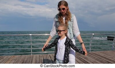 Mother And Daughter On Sea Pier