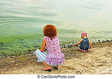 Mother and daughter on the bank