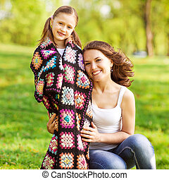 mother and daughter outdoors on a picnic