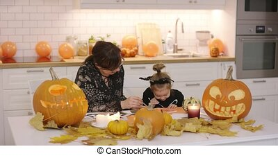 Mother and daughter painting decorations