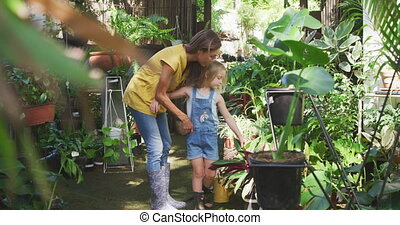Mother and daughter passing time together in a botanical ...