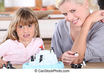 mother and daughter playing at home