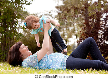 Mother and Daughter Playing in Park